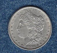 Buy 1880 Silver Morgan Dollar. It will easily grade exra fine +