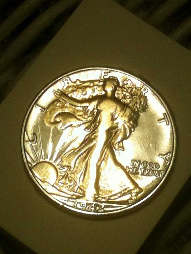 this coin is in great condition. The walking liberty is painted in gold.
