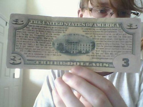 fake $3 bill with einstein and Bible verse on back