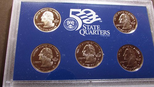 Lot of 2 proof sets including quarters: 2003, & 2004