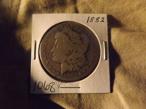 1882 MORGAN SILVER DOLLAR NICE COIN EVEN WEAR FOR 132 YEARS OLD
