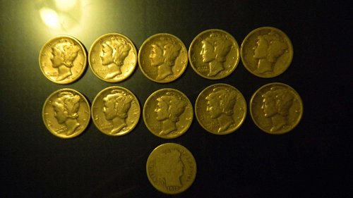 11 mercury dimes and one barber