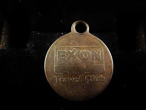 """Vintage Exxon Travel club keychain medal. It measures 1"""" in diameter."""