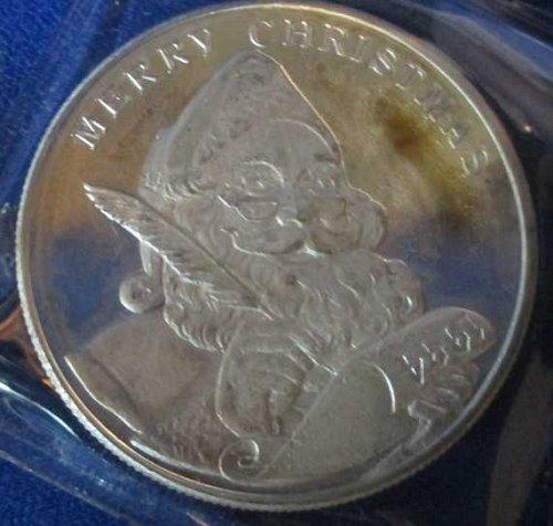 "One Troy Ounce .999 Fine Silver Coin ""Christmas 1994"""