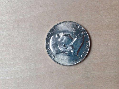 Brilliant Uncorculated 1957 D Franklin Half Dollar