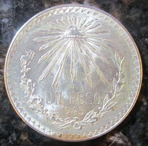 1945 Mexican Silver 1 Peso Silver Cap and Ray **BRILLIANT UNCIRCULATED**