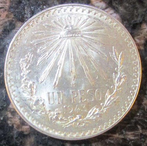 1943 Mexican Silver 1 Peso Silver Cap and Ray **BRILLIANT UNCIRCULATED*