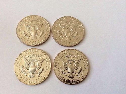 Four 1985 S Kennedy Half Dollars