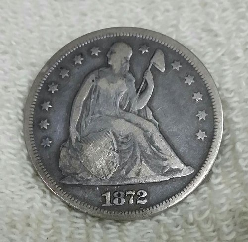 1872 Seated Dollar. You Grade