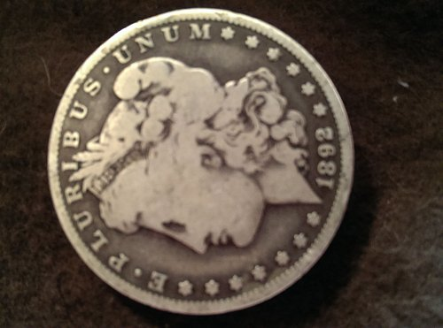 1892 O morgan Silver Dollar is worn but still tough date and key