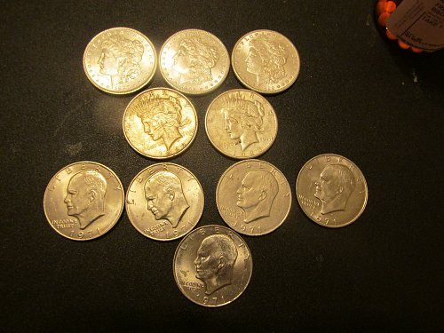 three mint morgans, two peaces, and five Eisenhoer