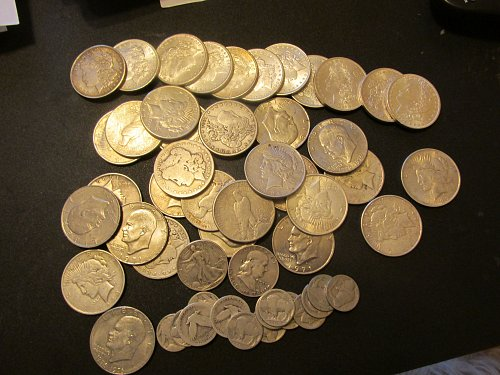 10 morgan mint, 5 morgans F,VF and 4 peace mint , 10 peace F,VF and see the belo