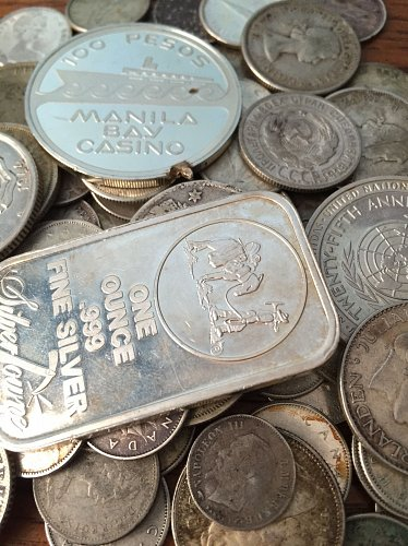 11.5 OZ of Silver World Coins and Silver Bullion Rounds Up to 99.99% Pure..