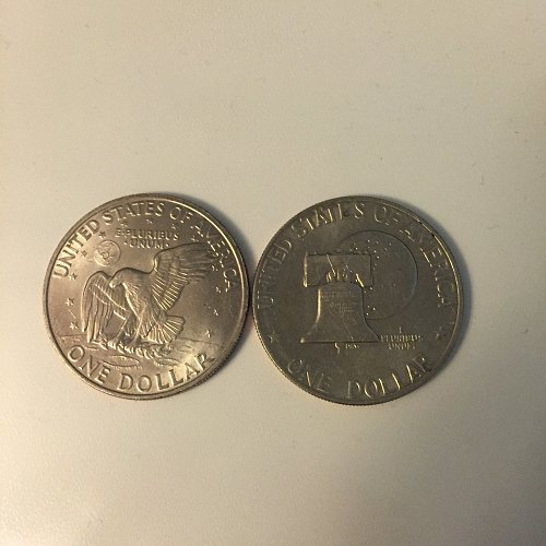 Two Uncirculated Eisenhower Dollars 1976 and 1971