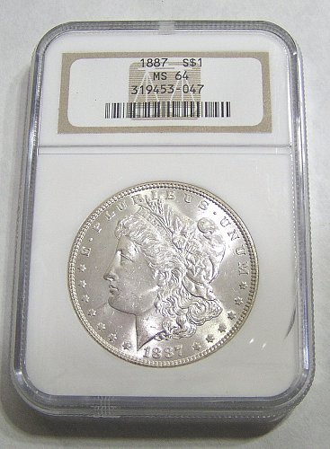 1887 Morgan Dollar - graded MS64 by NGC