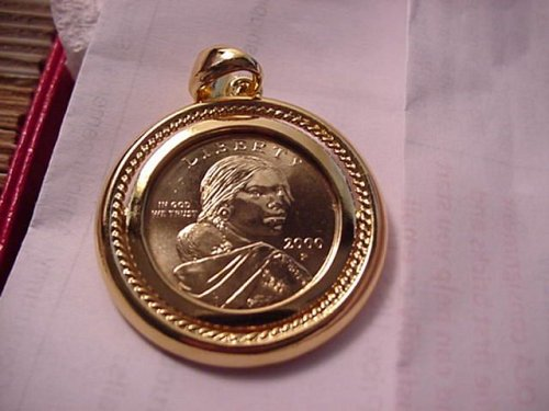great 2000p unc in gold color pendent..see photo