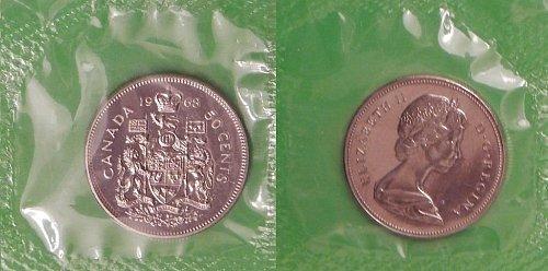 2-canada halfs 1968 & 1985 coat of arms