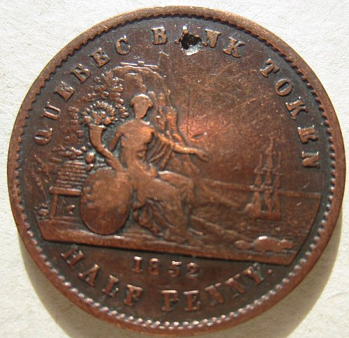1852 half penny quebec bank token with hole