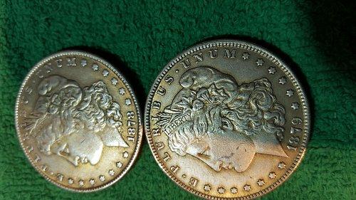 Two Morgan dollars.