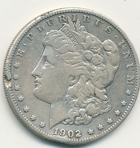 1902S Morgan dollar with rim damage