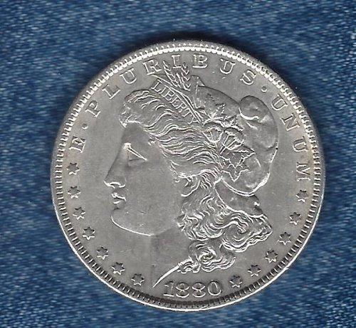 1880 Silver Morgan Dollar. It will easily grade exra fine +
