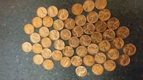 Full roll of uncirculated 1964 P pennies