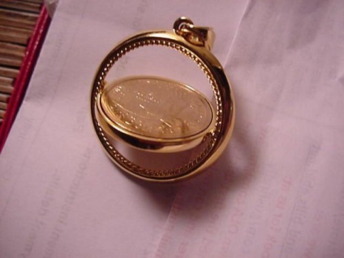 great 2000p unc in gold color pendent..see photo9(last one)