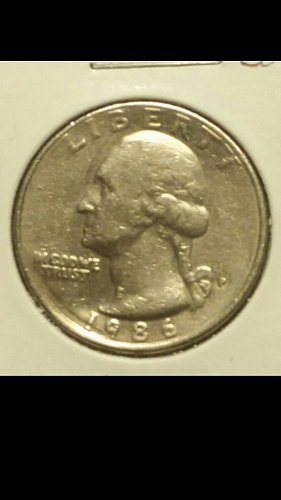 1986-P quarter strike through