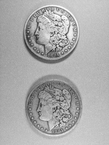 Lot 4:  Two coin set of Morgan dollars,1881o&s very nice coins.