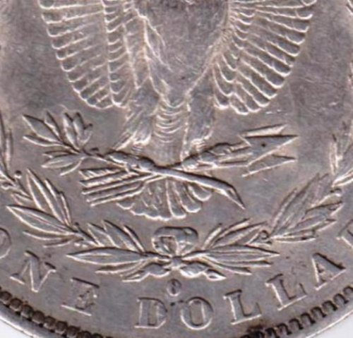 1882-O Morgan Dollar that ,to me, looks like O has a slanted line in middle of O