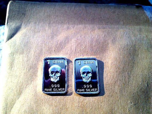 TWO BAR LOT, FINE .999 SILVER 1 GRAM  BARS  FRONT FACING SKULLS LOW SHIPPING