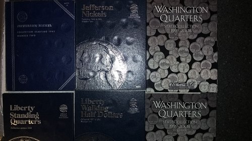 6 coin books  1 partially filled with quarters.