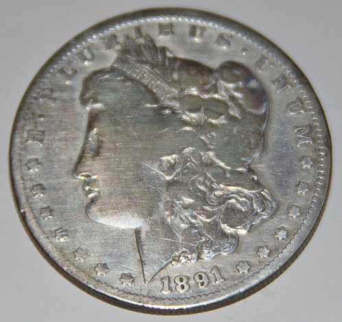 1891-O MORGAN SILVER DOLLAR...