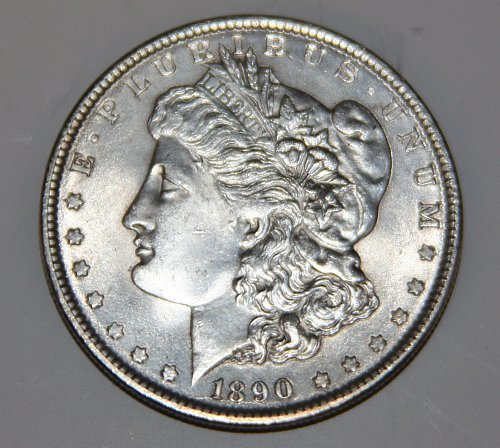 1890-P MORGAN SILVER DOLLAR DIE CRACK....AU+....GREAT STARTER COIN....