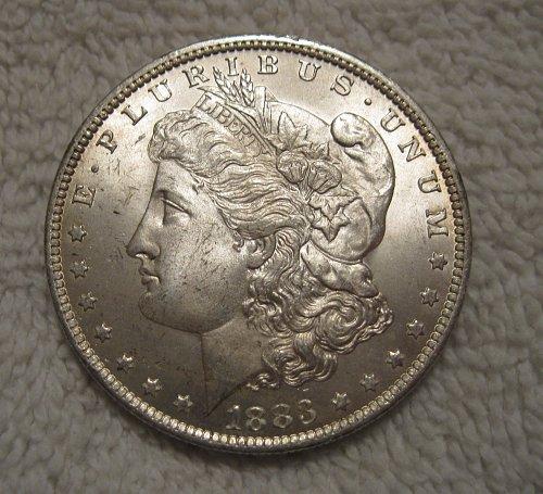 1883 O MORGAN SILVER DOLLAR,