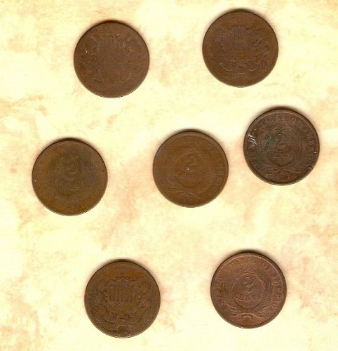 Seven well circulated Two Cent Pieces priced to go