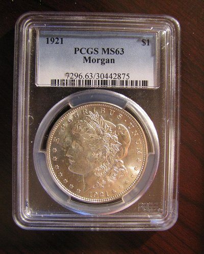 1921-P Morgan. Bright and Beautiful with beauty mark on behind.