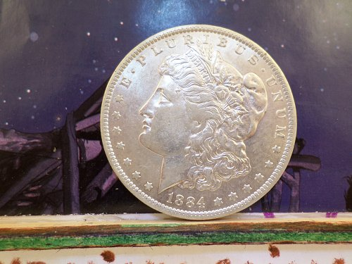 A VERY NICE 1884-O MORGAN DOLLAR