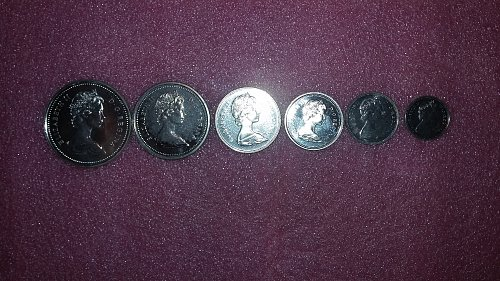 1873-1973 Canadian silver dollar and clad