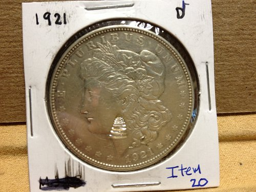 1921 D Morgan Dollar item20.  Tore plastic on Frt not on coin