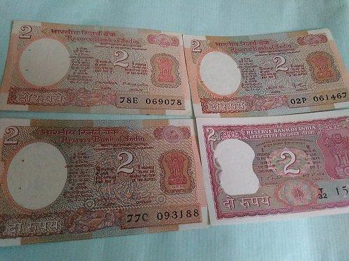 India...2Rupee..4 diff. sign