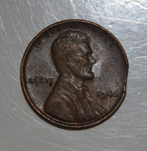 COLLECTIBLE ERROR COIN 1945 CLIPPED WHEAT PENNY.....
