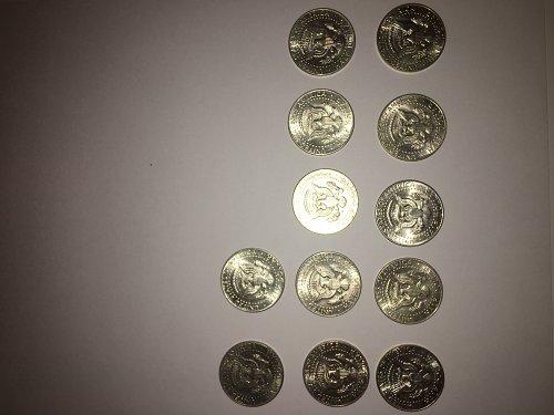 12  1964 Kennedy Half Dollars.