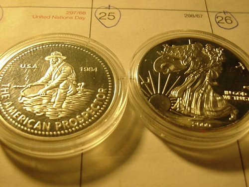 2-copy silver coins..they are not silver,but says 1 oz silver