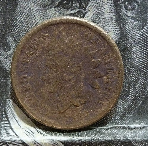 Here is an 1860 Filler Indian Cent has surface issues. (  2001 )