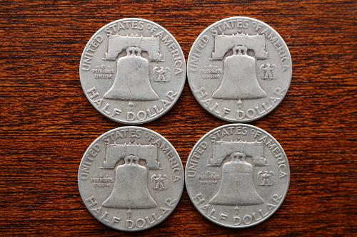 4 Franklin half dollars in a group