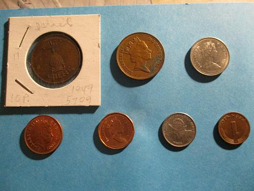 Small lot of 7 foreign coins    (see photos)