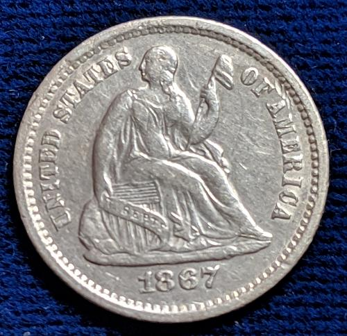 1867S EXTREMELY FINE SEATED LIBERTY HALF