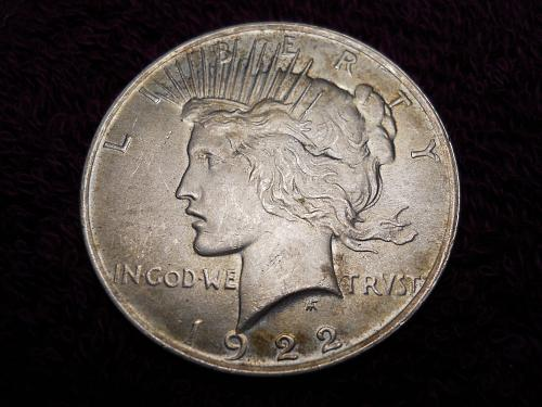 1922 (P) Peace Silver Dollar.  Mint State.  Golden Hues of Toning!