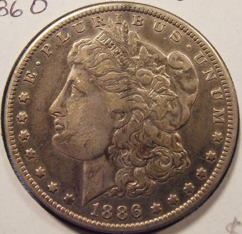 1886 O Morgan Silver Dollar (86O10)